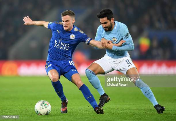 Andy King of Leicester City holds off Ilkay Gundogan of Manchester City during the Carabao Cup QuarterFinal match between Leicester City and...