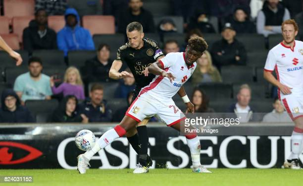 Andy King of Leicester City in action with Aaron Tshibola of MK Dons during the pre season friendly between MK Dons and Leicester City on July 28th...