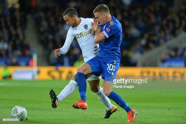 Andy King of Leicester City in action with Cameron BorthwickJackson during the Carabao Cup fourth round match between Leicester City and Leeds United...