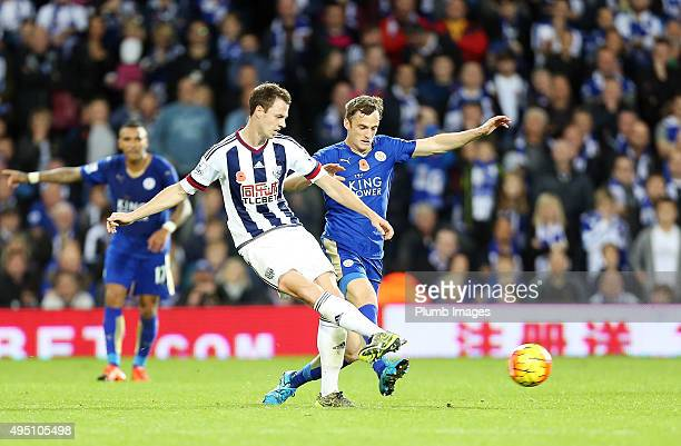 Andy King of Leicester City in action with Jonny Evans of West Brom during the Premier League match between West Bromwich Albion and Leicester City...
