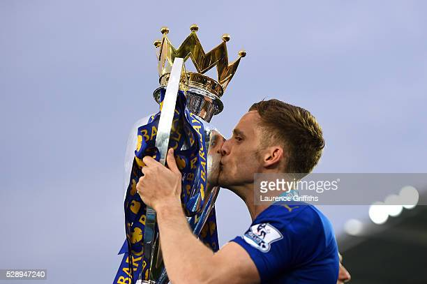 Andy King of Leicester City kisses the Premier League Trophy as players and staffs celebrate the season champions after the Barclays Premier League...
