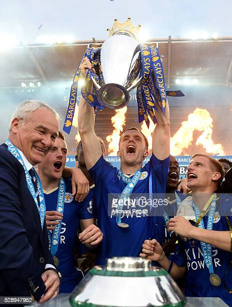 Andy King of Leicester City lifts the Premier League Trophy as players and staffs celebrate the season champions after the Barclays Premier League...