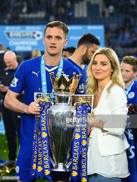 Andy King of Leicester City poses for photographs wit the Premier League Trophy after the Barclays Premier League match between Leicester City and...