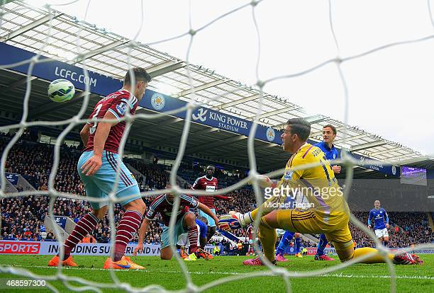 Andy King of Leicester City scores their second goal past Adrian of West Ham during the Barclays Premier league match Leicester City and West Ham...
