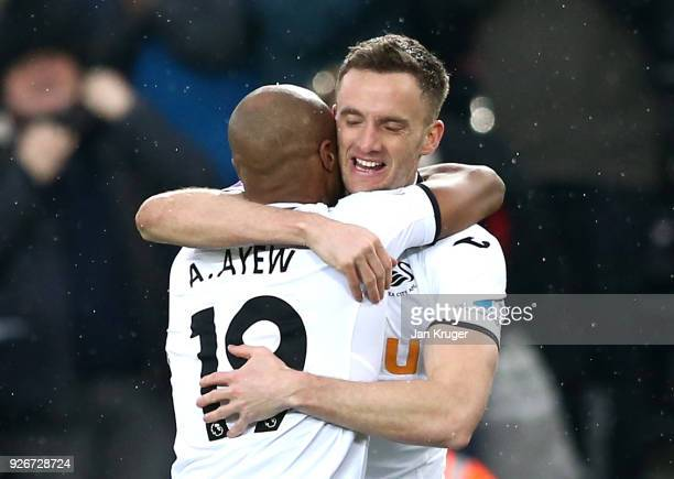Andy King of Swansea City celebrates with Andre Ayew of Swansea City after scoring his sides third goal during the Premier League match between...