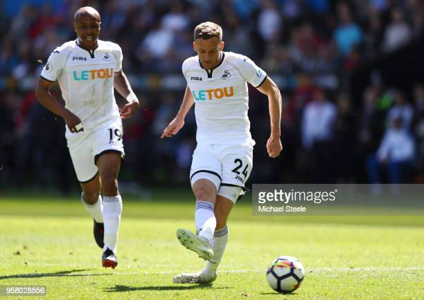 Andy King of Swansea City scores his sides first goal during the Premier League match between Swansea City and Stoke City at Liberty Stadium on May...