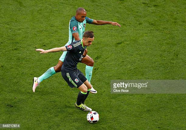 Andy King of Wales and Joao Mario of Portugal compete for the ball during the UEFA EURO 2016 semi final match between Portugal and Wales at Stade des...