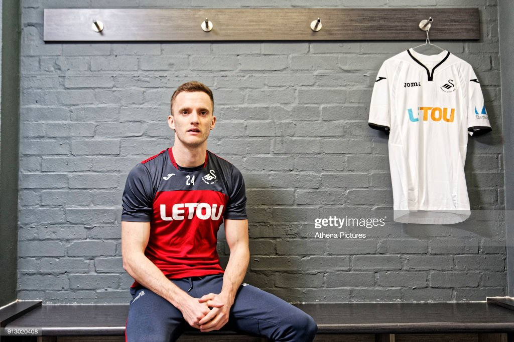 Andy King poses for a portrait as he is unveiled as a new Swansea City signing at The Fairwood Training Ground on February 01, 2018 in Swansea, Wales.