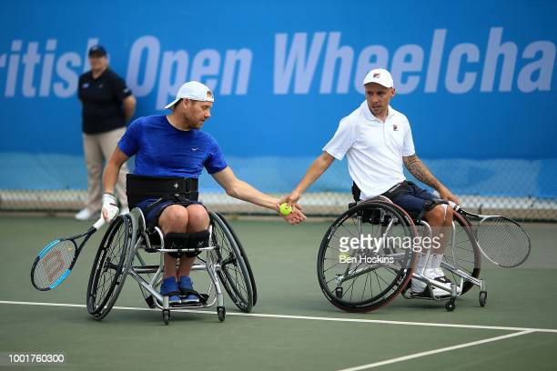 Andy Lapthorne and Anthony Cotterill of Great Britain in action during their men's quad doubles semi final against Shota Kawano of Japan and Ymanitu...