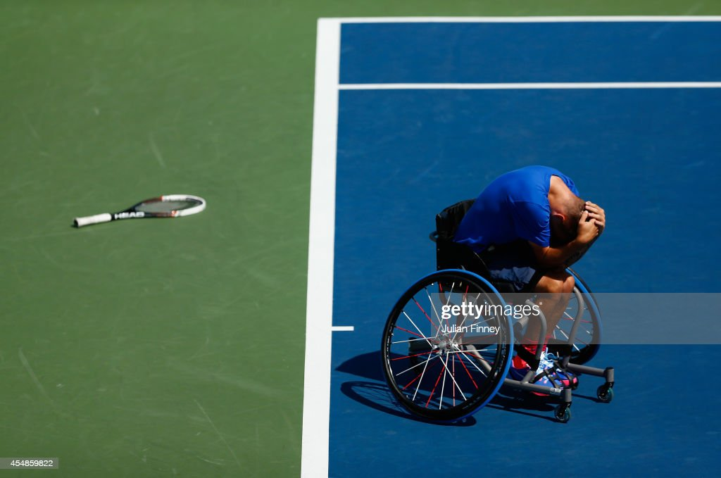 Andy Lapthorne of Great Britain celebrates match point against David Wagner of the United States during the men's wheelchair quad singles final on Day fourteen of the 2014 US Open at the USTA Billie Jean King National Tennis Center on September 7, 2014 in the Flushing neighborhood of the Queens borough of New York City.