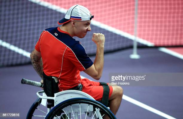 Andy Lapthorne of Great Britain celebrates winning a point during his first round match against Anthony Cotterill of Great Britain on Day 1 of the...