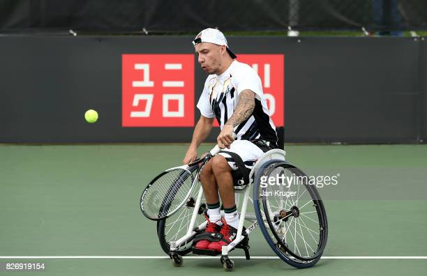 Andy Lapthorne of Great Britain in action against David Wagner of United States of America in the quad singles final during the British Open...