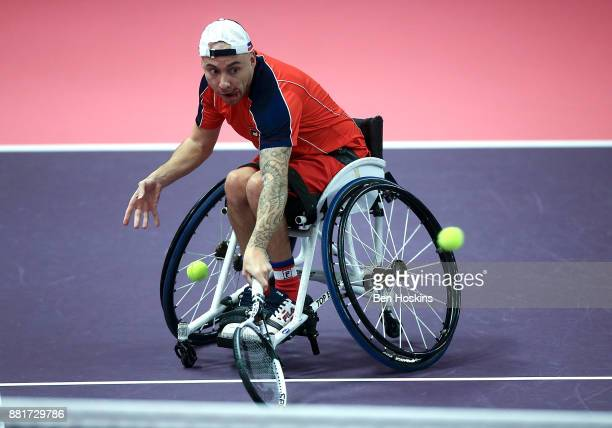 Andy Lapthorne of Great Britain in action during his first round match against Anthony Cotterill of Great Britain on Day 1 of the NEC Wheelchair...