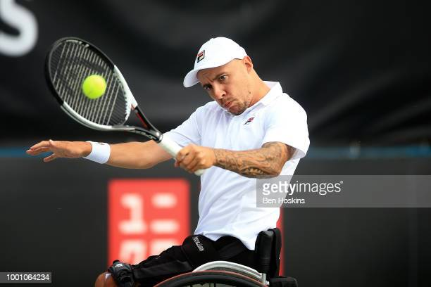 Andy Lapthorne of Great Britain plays a backhand during his match against Ymanitu Silva of Brazil on day two of The British Open Wheelchair Tennis...