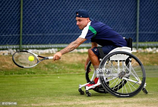Andy Lapthorne of Great Britain plays a backhand during his Quad Singles Final match against David Wagner of the USA during day three of the Surbiton...