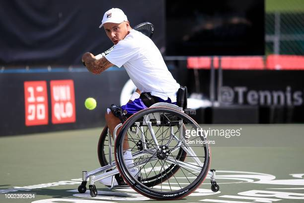 Andy Lapthorne of Great Britain plays a backhand during his quad semi final match against Koji Sugeno of Japan on day four of The British Open...