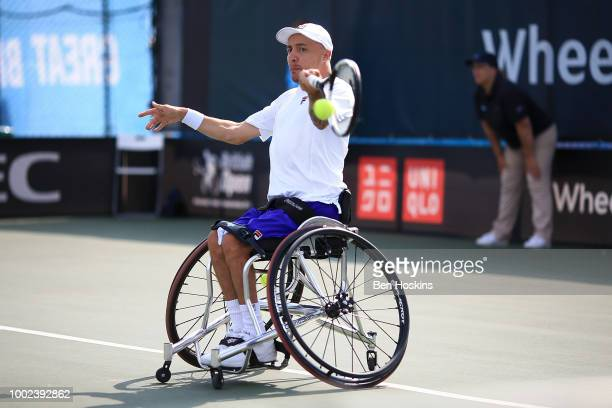 Andy Lapthorne of Great Britain plays a forehand during his quad semi final match against Koji Sugeno of Japan on day four of The British Open...