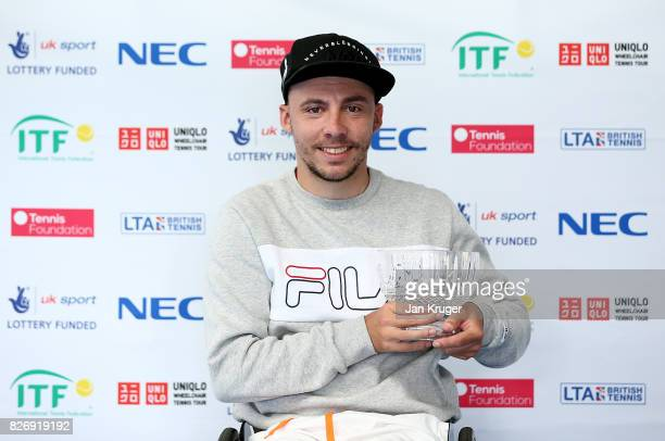Andy Lapthorne of Great Britain poses with the runners up trophy after the quad singles final during the British Open Wheelchair Tennis at The...