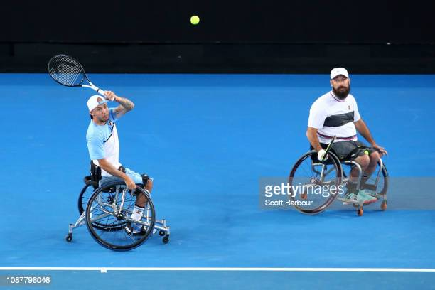 Andy Lapthorne of Great Britain serves in his Quad Wheelchair Doubles Final with David Wagner of the United States against Dylan Alcott and Heath...