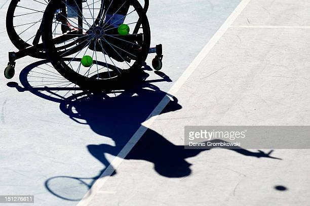Andy Lapthorne of Great Britain serves in the Quad Doubles Wheelchair Tennis Gold Medal match on day 7 of the London 2012 Paralympic Games at Eton...