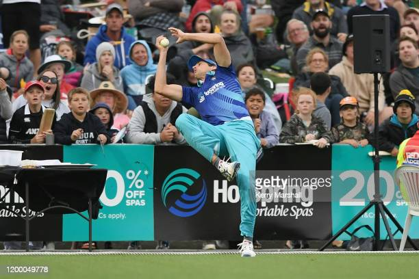 Andy Lee from team cricket takes a catch just inside the boundary rope to dismiss Jordie Barrett during the T20 Black Clash at McLean Park on January...