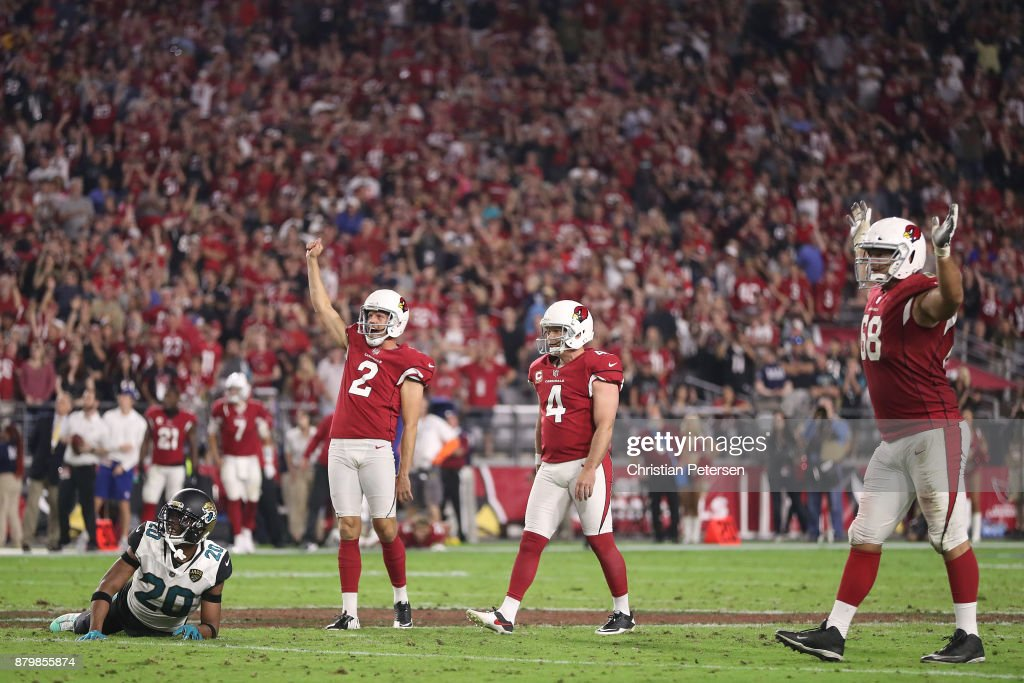 Andy Lee #2, Phil Dawson #4 and Jared Veldheer #68 of the Arizona Cardinals celebrate after Dawson scores a 57 yard game winning field goal against the Jacksonville Jaguars in the second half at University of Phoenix Stadium on November 26, 2017 in Glendale, Arizona. The Arizona Cardinals won 27-24.
