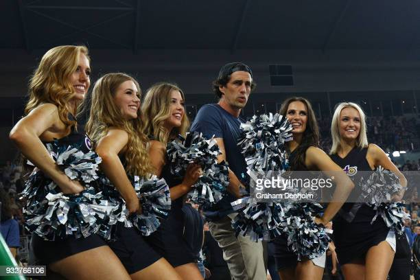 Andy Lee poses with cheerleaders during game one of the NBL Grand Final series between Melbourne United and the Adelaide 36ers at Hisense Arena on...