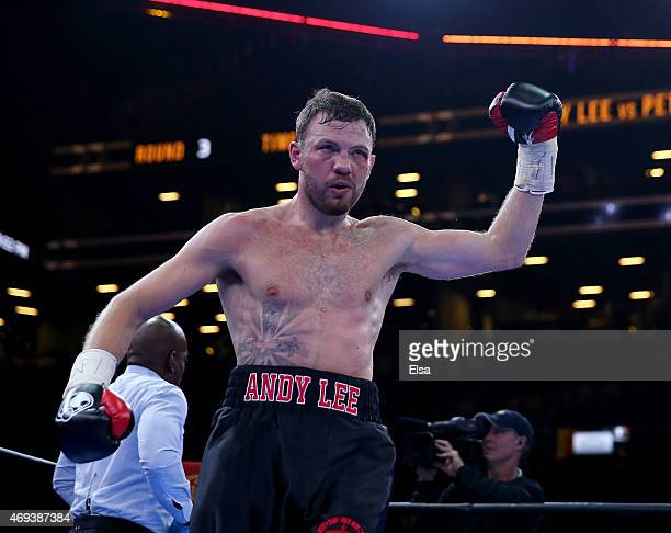 Andy Lee reacts as he heads to his corner after a round against Peter Quillin during the Premier Boxing Champions Middleweight bout at Barclays...
