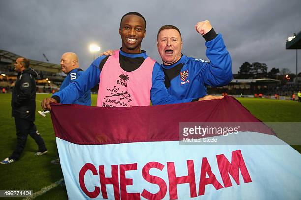 Andy Leese the manager of Chesham United celebrates his sides 10 victory at the final whistle alongside goalscorer Ryan Blake during the Emirates FA...