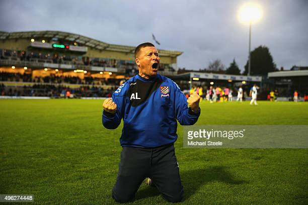 Andy Leese the manager of Chesham United celebrates his sides 10 victory at the final whistle during the Emirates FA Cup first round match between...
