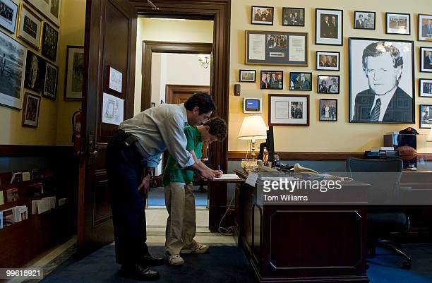 Andy Litsky of D.C. And his nephew Robert Litsky of New York City, sign a condolence book in the Russell office of Sen. Ted Kennedy, D-Mass., who...
