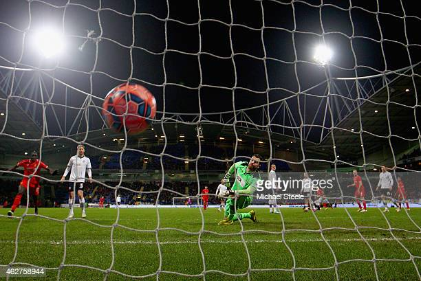 Andy Lonergan of Bolton Wanderers looks back as Philippe Coutinho of Liverpool scores the second goal during the FA Cup Fourth round replay between...