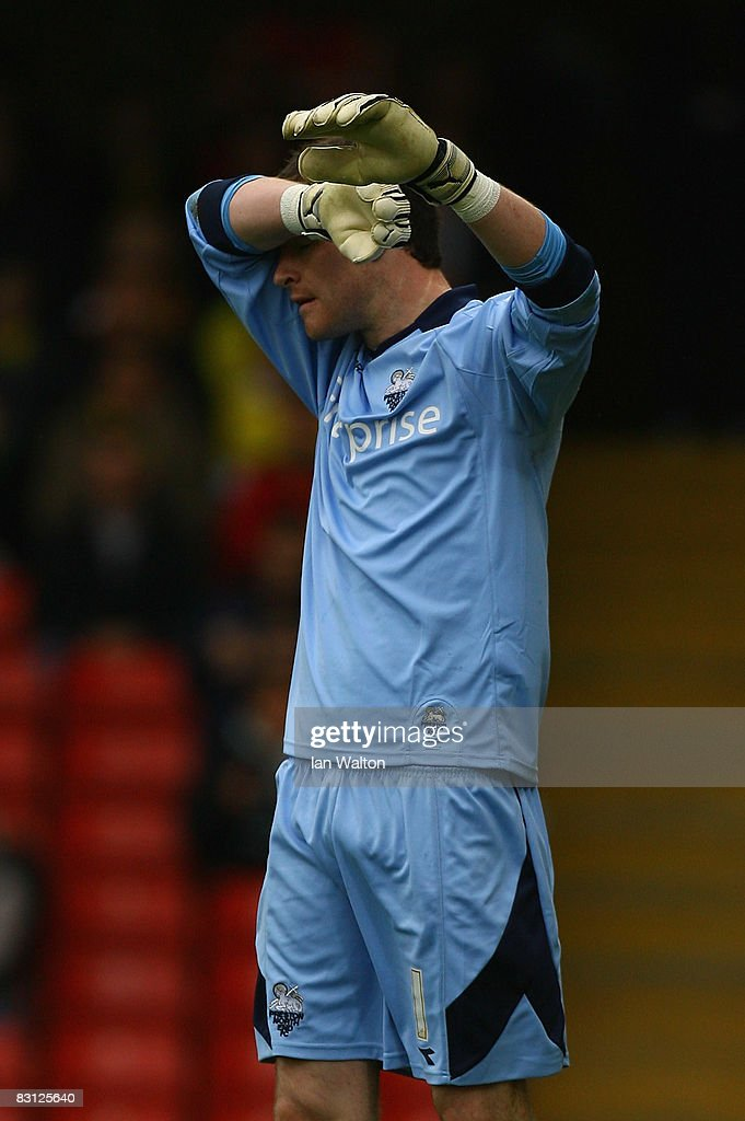 Andy Lonergan of Preston raises his arms during the Coca-Cola Championship match between Watford and Preston North End at Vicarage Road on October 04, 2008 in Watford, England.