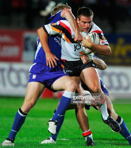 Andy Lynch of Bradford is stopped by the Bradford defence during the Engage Super League match between Bradford Bulls and Hull FC at the Odsal...