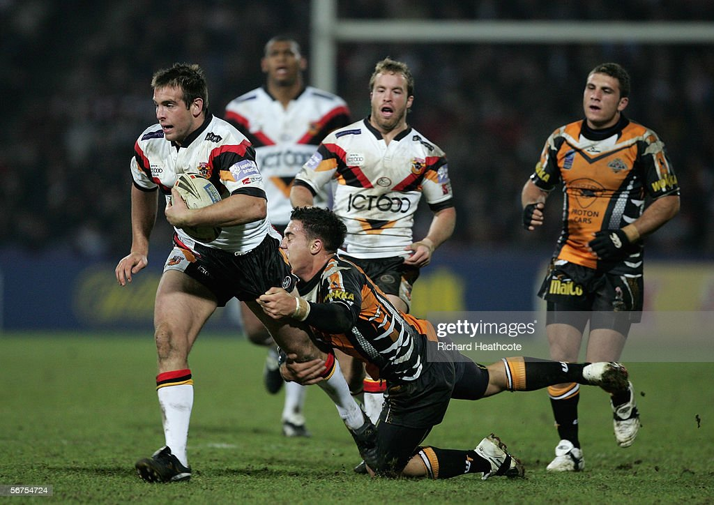 Andy Lynch of Bradford shakes off the tackle of Bronson Harrison of the Tigers during the Carnegie World Club Challenge between Bradford Bulls and Wests Tigers at the Galpharm Stadium on February 03, 2006 in Huddersfield, England