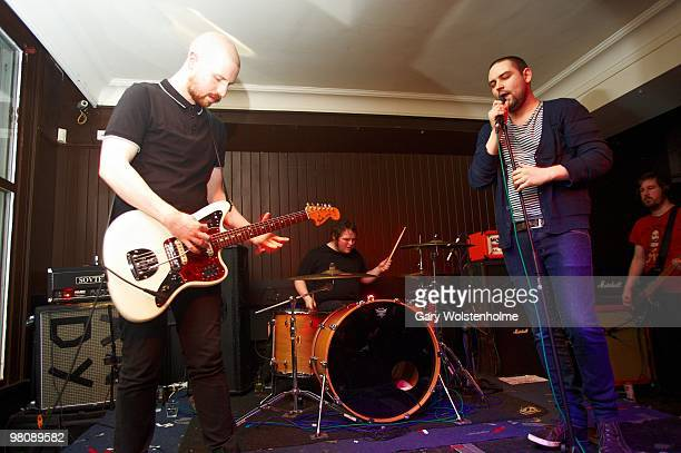 Andy MacFarlane, Mark Devine and James Graham of The Twilight Sad perform on stage at The Harley on March 27, 2010 in Sheffield, England.