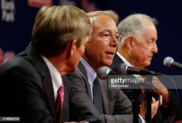 Andy MacPhail center answers a question asJohn Middletown left part owner of Philadelphia Phillies and president Pat Gillick right listen in during a...
