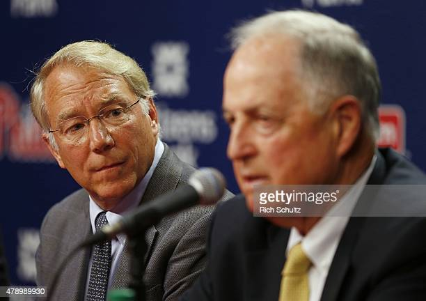 Andy MacPhail left listens as Philadelphia Phillies President Pat Gillick answers a question during a press conference at Citizens Bank Park on June...