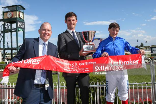 Andy Makiv from Godolphin James Cummings and Craig Williams pose with the trophy after winning the Ladbrokes CF Orr Stakes at Caulfield Racecourse on...