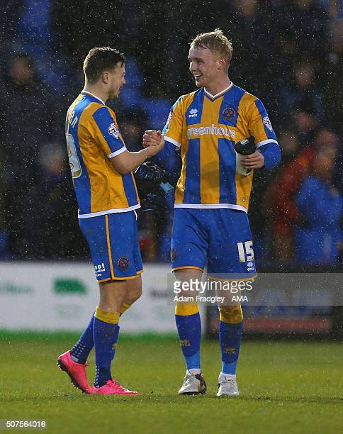 Andy Mangan of Shrewsbury Town congratulates Jack Grimmer of Shrewsbury Town after the Emirates FA Cup match between West Bromwich Albion and...