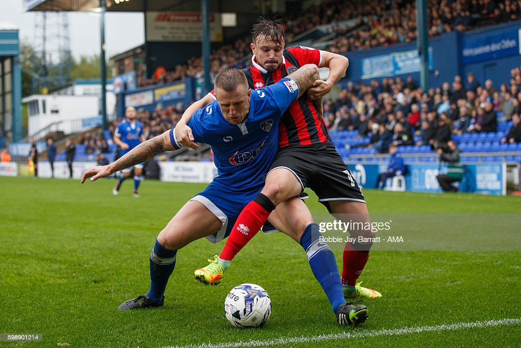 Andy Mangan of Shrewsbury Town tussles with Peter Clark of Oldham Athletic during the Sky Bet League One match between Oldham Athletic and Shrewsbury Town at Boundary Park on September 3, 2016 in Oldham, England.