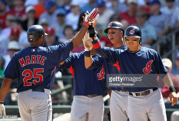 Andy Marte of the Cleveland Indians is congratulates by teammates Anderson Hernandez Michael Brantley and ShinSoo Choo after Marte hit a first inning...