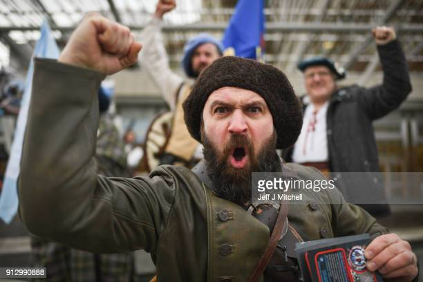 Andy McAlindon and Culloden Battlefield campaigners protest outside the Scottish Parliament on February 1 2018 in Edinburgh Scotland The group were...