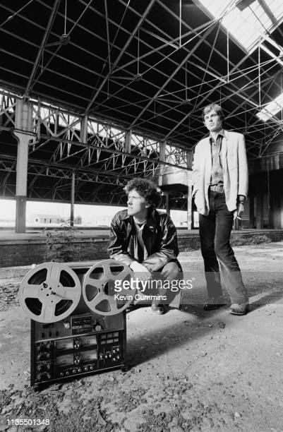 Andy McCluskey and Paul Humphreys of British duo OMD in an old warehouse in Liverpool 17th July 1979 In the foreground is a Teac 4 track taperecorder...