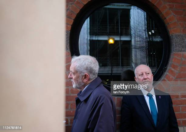 Andy McDonald MP for Middlesbrough listens as Labour leader Jeremy Corbyn conducts a media interview during a visit to Middlesbrough Centre Square on...