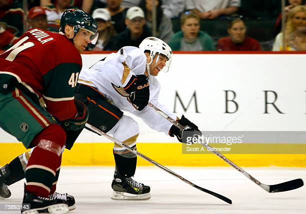 Andy McDonald of the Anaheim Ducks gets a shot on goal as Martin Skoula of the Minnesota Wild defends in Game 3 of the 2007 Western Conference...