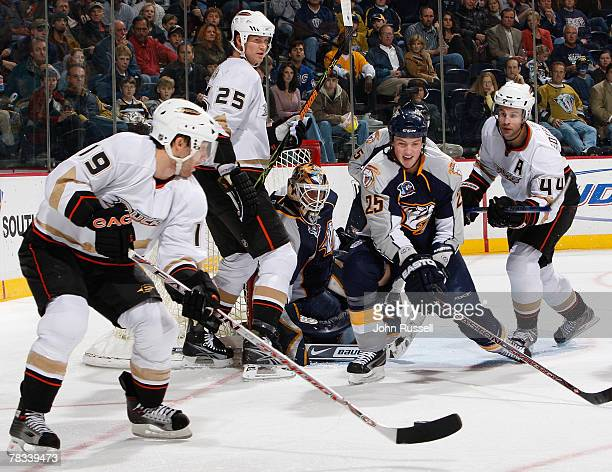 Andy McDonald of the Anaheim Ducks looks to shot the puck against Jerred Smithson and Chris Mason of the Nashville Predators as Chris Pronger and Rob...