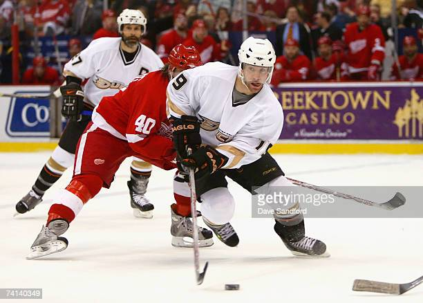 Andy McDonald of the Anaheim Ducks skates with the puck past Henrik Zetterberg of the Detroit Red Wings during the first period of game two of the...