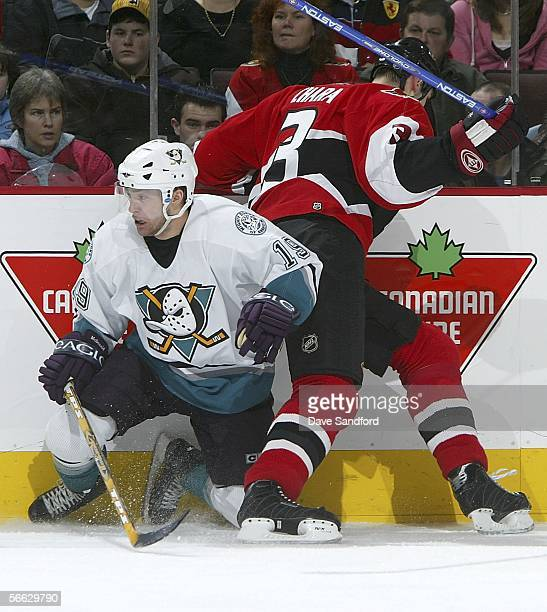Andy McDonald of the Mighty Ducks of Anaheim battles along the boards with Zdeno Chara of the Ottawa Senators during their NHL game at Scotiabank...