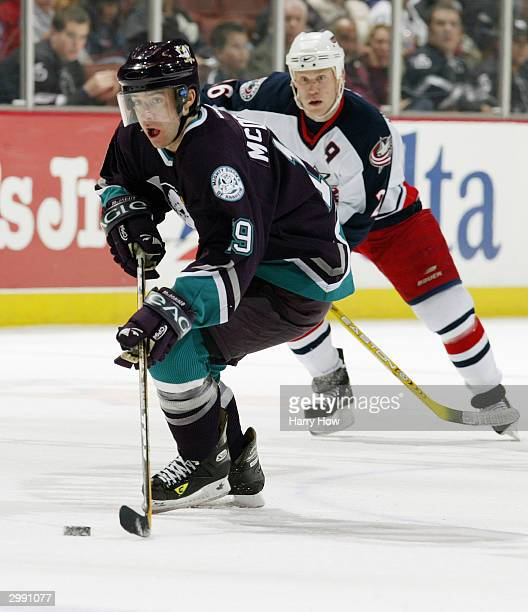 Andy McDonald of the Mighty Ducks of Anaheim looks to make a play with the puck in the high slot against of the Columbus Blue Jackets during the game...